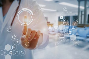 female doctor with stethoscope hand pointing touching data digital icon hologram with blurred image of lobby for waiting in hospital background, innovation, medical, future and technology concept.